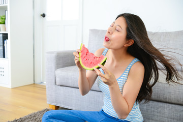 attractive lady enjoying sweet watermelon