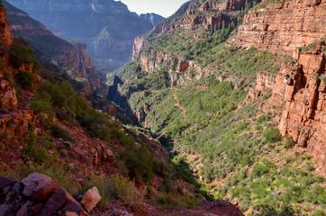 layered steep cliffs and  Redwall bridge at the bottom of Roaring Springs Canyon North Rim, Grand Canyon National Park, Arizona, USA
