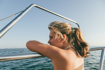 Pensive Little Girl in the Sea