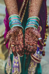 Henna-painted hands, India