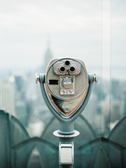Tower binoculars overlooking city