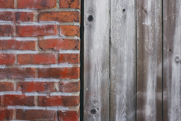 Detail of old brick wall and wood siding