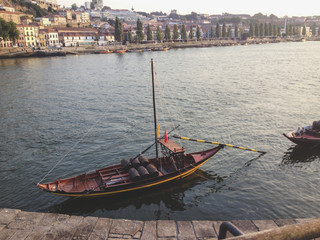Typical rabelo boat and Porto historical district in background, Portugal