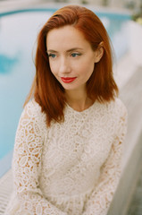 Portrait of beautiful ginger woman with red lips