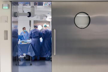 Open door of a working operating room