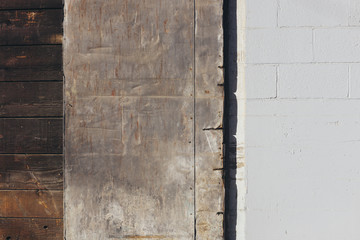 Architectural detail of old warehouse door and wall
