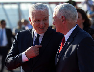 Montenegrin Prime Minister Dusko Markovic talks with U.S. Vice President Mike Pence after welcoming ceremony at airport in Podgorica