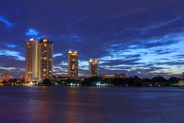 high building at the river in sunset time
