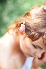 Young beautiful woman walks in flowery Park. Portrait of a young woman. Happy girl. Summer.