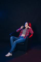 Woman smoking electronic cigarette with smoke