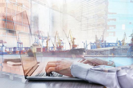 Businessman using laptop, close up