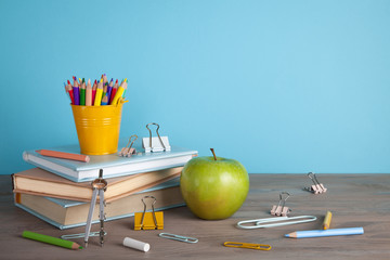 Back to school concept with school supplies. Colorful pencils, books with copy space