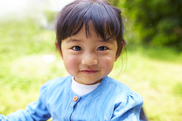 close up of lovely little asian girl smile at camera