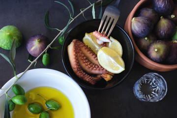 Baked octopus.  Olive oil and ripe figs.