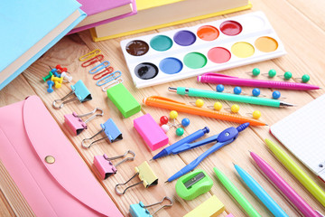 School supplies on brown wooden table