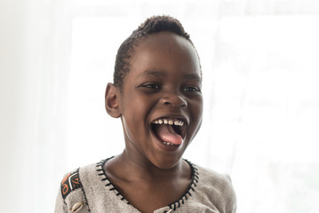 A Young Black Boy Gives Large Grin