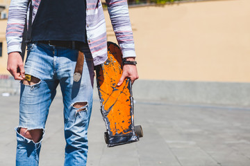 Teen Skater with Worn Skateboard