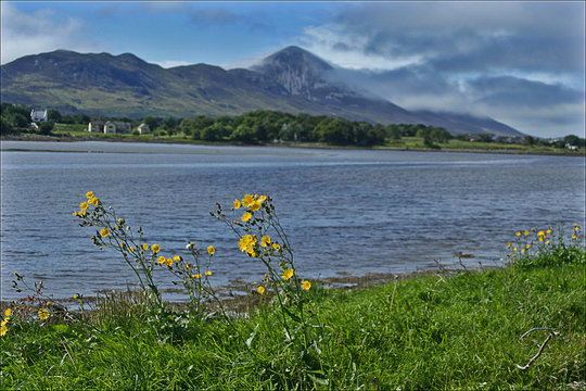 """Clouds at the dome of Croagh Patrick """"Cruchán Aigli"""" viewed from Westport Quay, Westport, Ireland"""