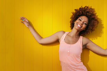 Latin American Afro Woman Against a Yellow Background in a Summer Day