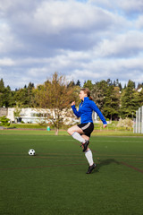 Female soccer player warming up on field