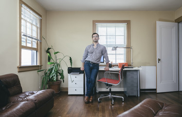 Portrait of Young Man with Casual Home-Based Small Business