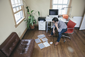 Male Interior Designer Working with Material Finishes Swatch at Home Office Small Business