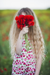 Little girl holding bouquet of poppies