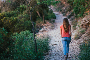 woman walking on the little road