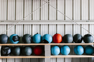 Heavy medicine balls lined up in an indoor gym