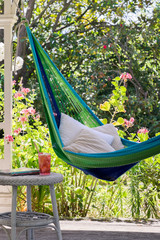 Hammock hung on porch of country homestead