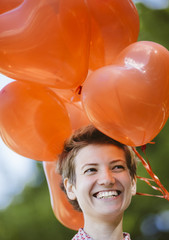 happy woman with red balloons