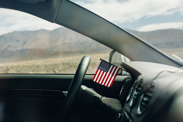 Little american flag in the car