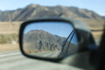 Mountain in a car mirror