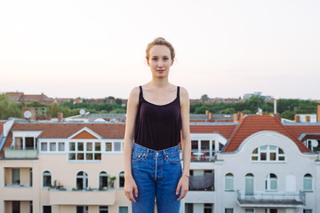 Young woman on rooftop in Berlin