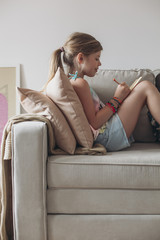 Cute Blonde Girl Drawing at Home