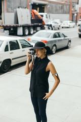 Stylish photographer taking a photo