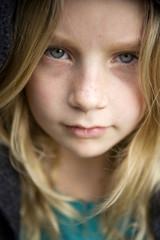 Intense Portrait Of Pre-Teen Green Eyed Girl
