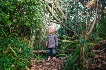 Little girl playing in forest
