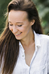 happy beautiful young woman with eyes closed