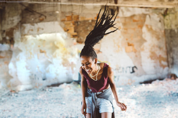 Woman with Dreadlocks dancing indoors