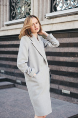 Beautiful woman wearing grey coat