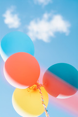 colored  balloons against blue sky