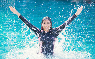 World environment day concept: concept: Asian woman jumping on the pool