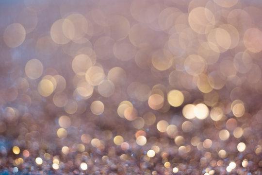 Abstract golden glitter vintage lights background. Defocused gold bokeh abstract background light.