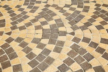 Sidewalk tile pattern, fan motifs or wave shapes.