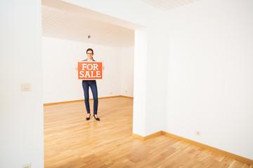 Realtor In Empty Apartment