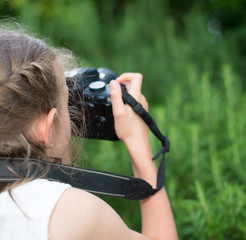 Cute little girl doing photographs of nature.