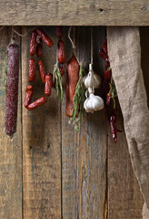 Sausages with rosemary , garlic and pepper.