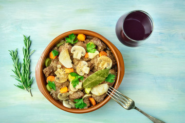 Overhead photo of meat and mushrooms ragout with wine