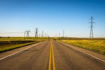 Electricity Pillars along an empty road in Canada